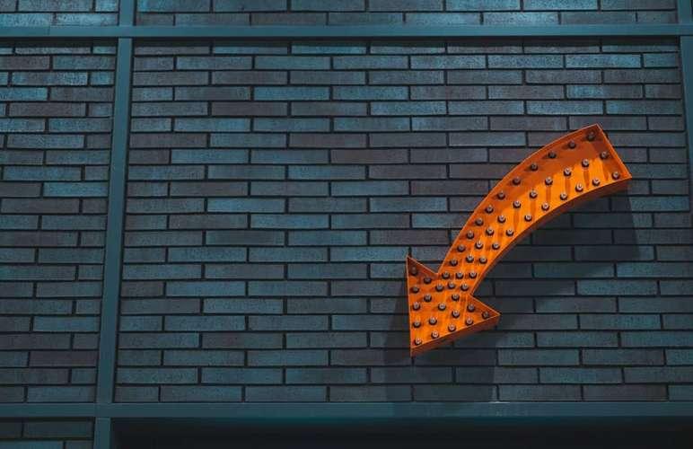 An orange downwards arrow.