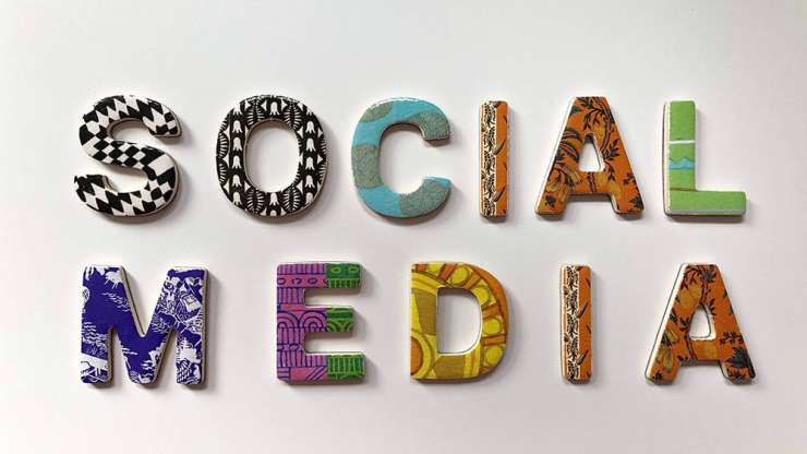Socia media words with colourful letters.