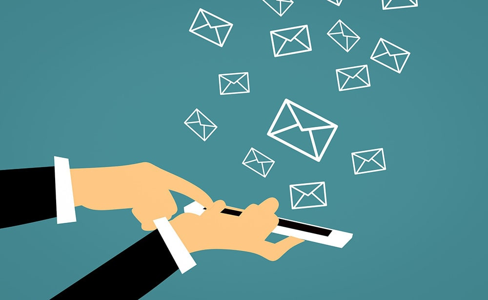 A person sending multiple emails via phone.